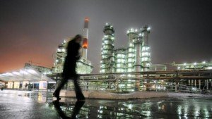 A man walks in front of the Novokuibyshevsk refinery near the city of Samara, Russia in this October 28, 2010 file photo. REUTERS/Nikolay Korchekov/Files